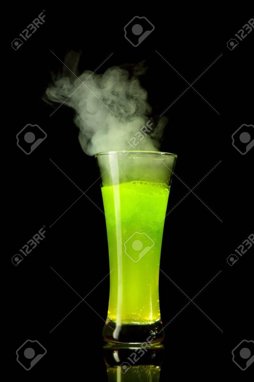 Boiling radioactive green alcohol with smoke, studio shot isolated on black background Stock Photo - 7484942