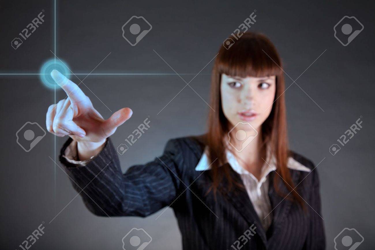 Business woman pointing on sensor screen, high technology concept Stock Photo - 9466866