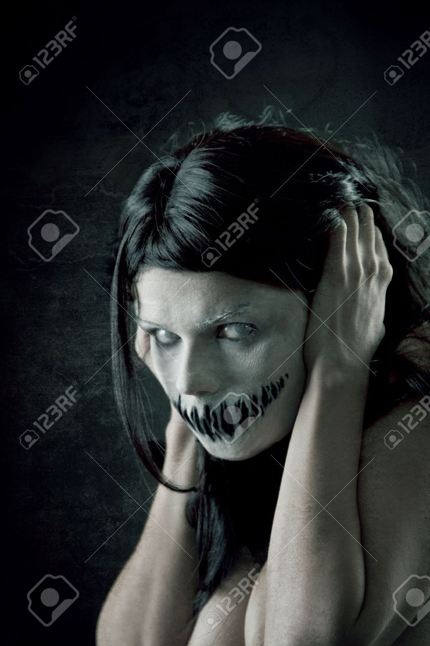 Horrible girl with scary mouth and eyes, extreme body-art Stock Photo - 10546190