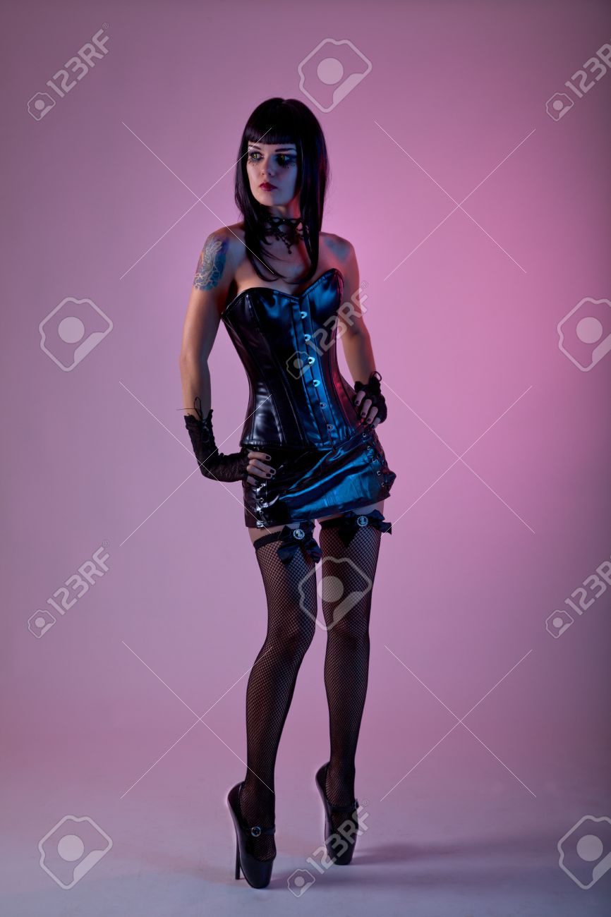 Fetish woman wearing leather corset and extreme ballet shoes, studio shot Stock Photo - 10842688