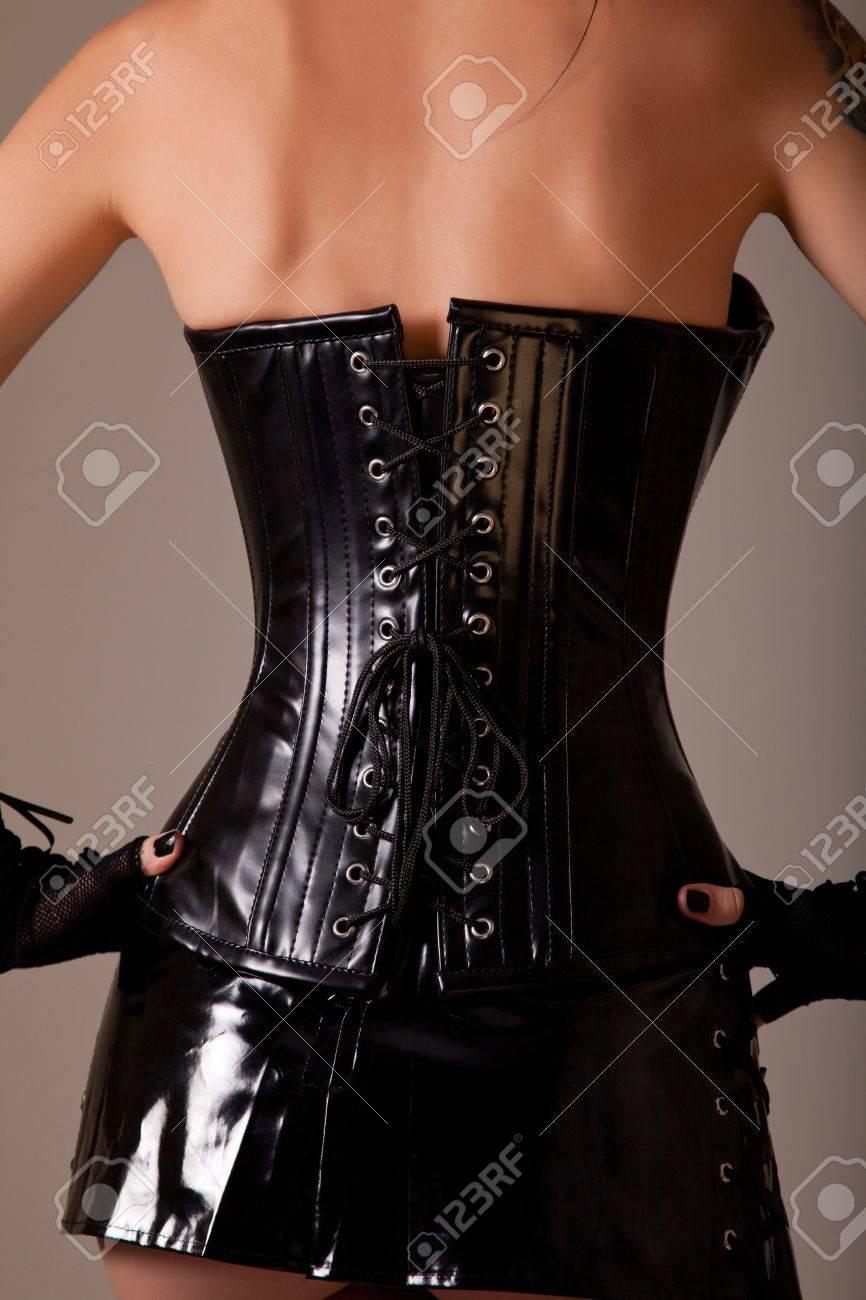 Woman wearing professional waist training corset for hourglass