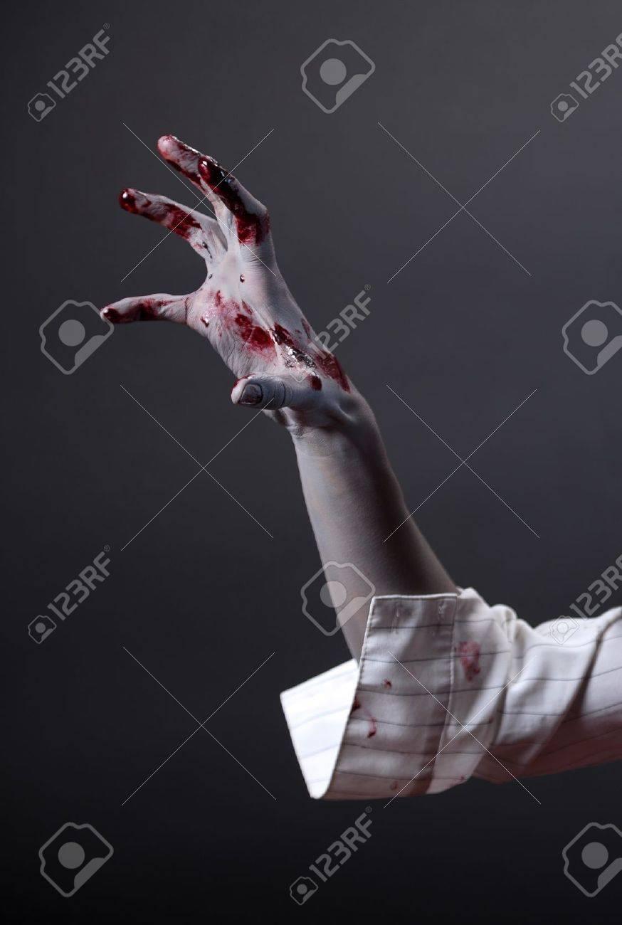 Creepy zombie hand extreme body art studio shot stock photo 12704772