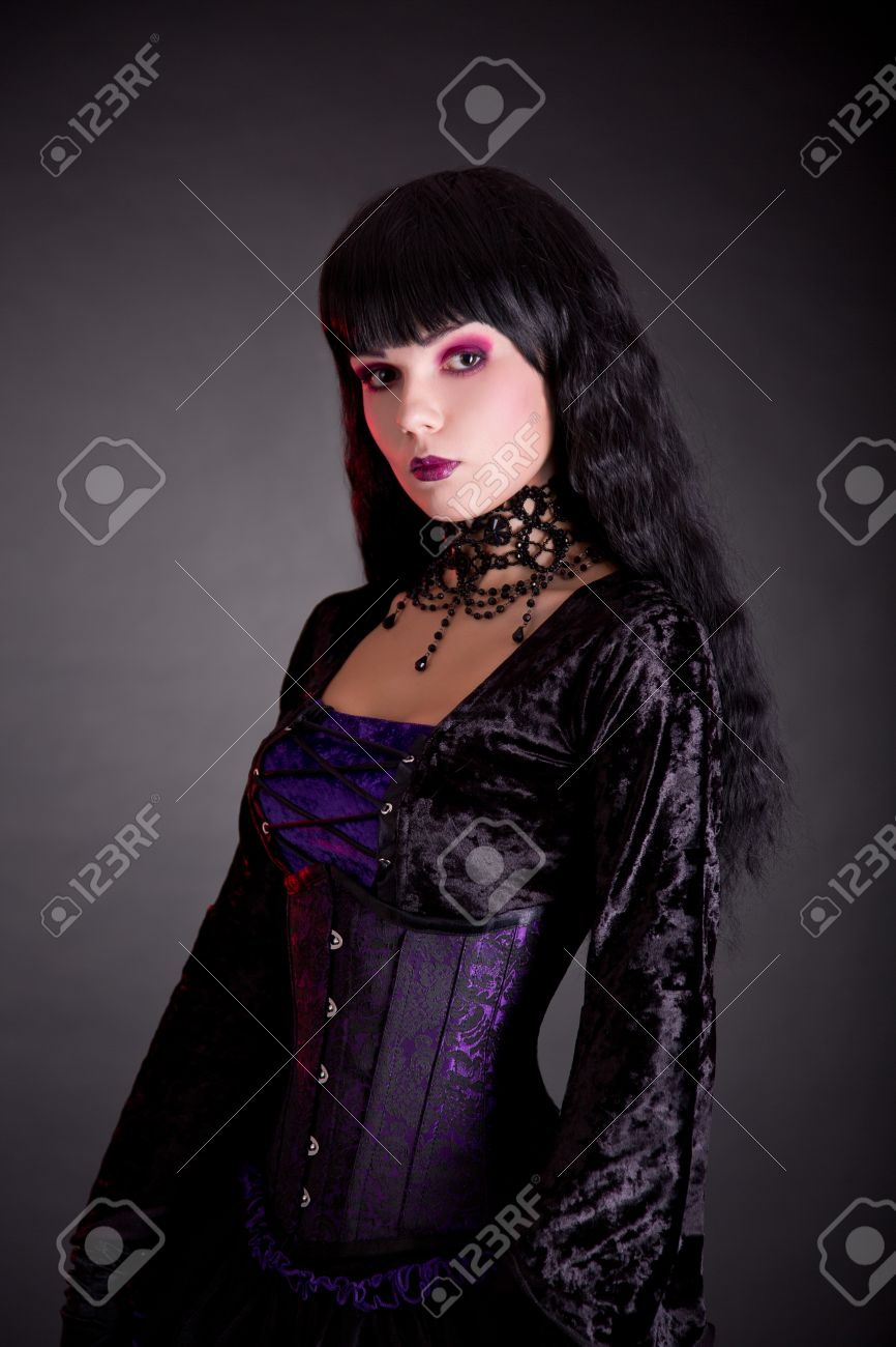 Portrait of beautiful gothic girl in Victorian style clothes, studio shot on black background Stock Photo - 23571164
