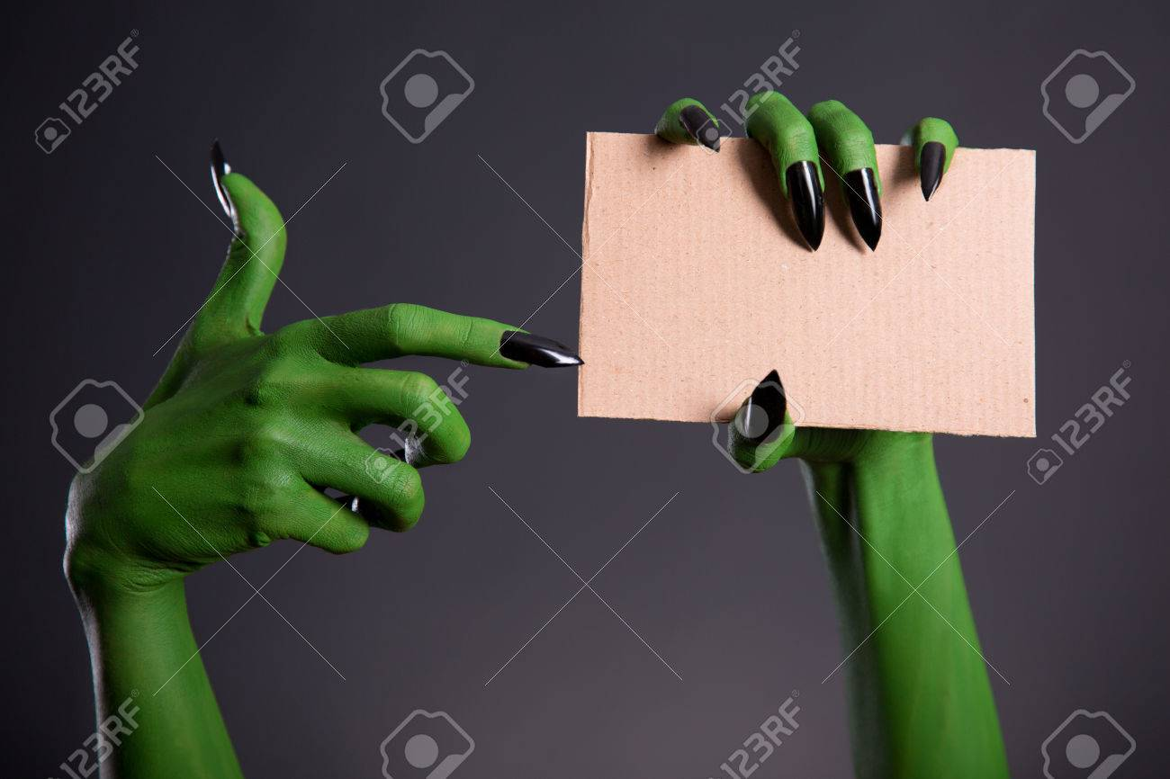 Green Monster Hand With Black Nails Pointing On Blank Piece Of ...