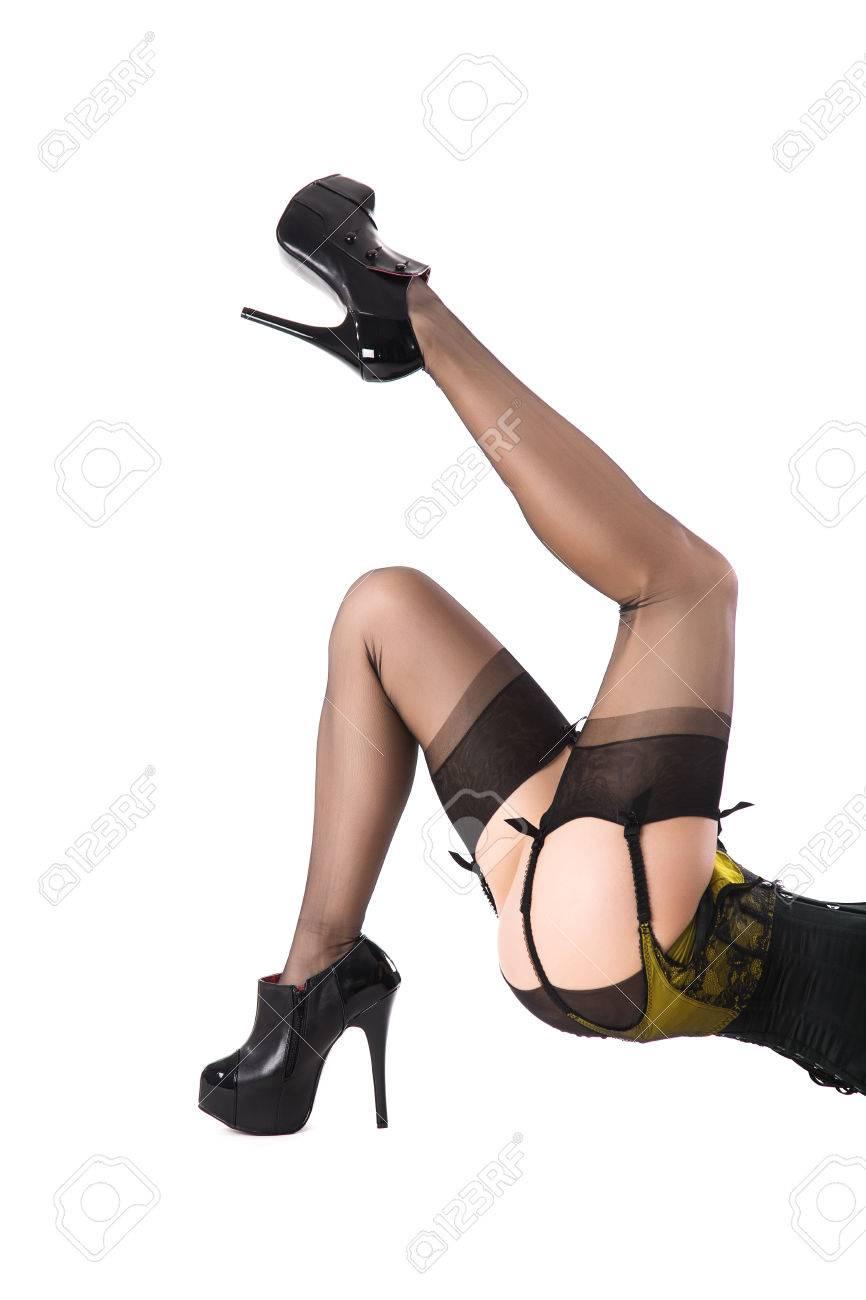 ea16365f1b Foto de archivo - Sexy piernas femeninas en medias de nylon