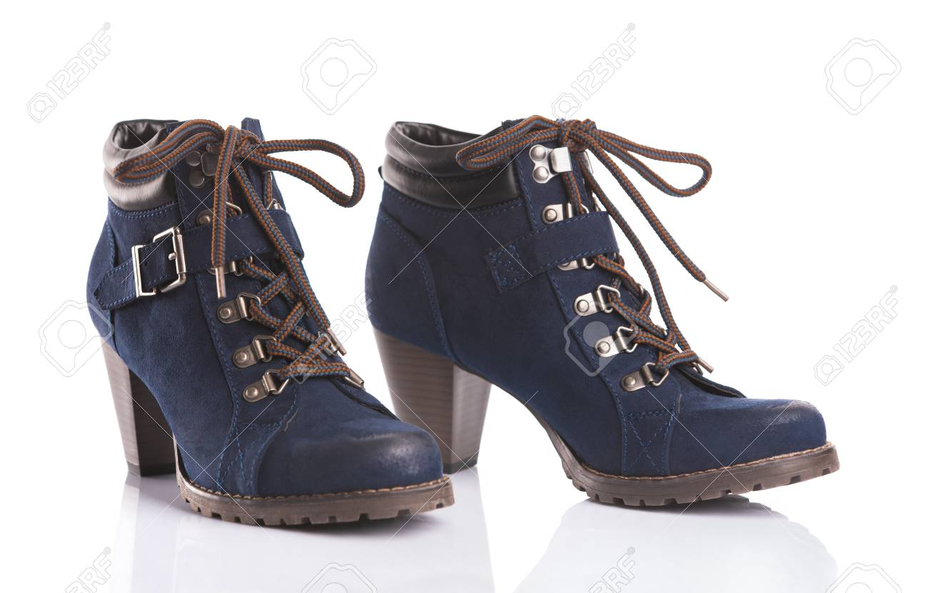 Pair Of Navy Blue Ankle Boots Isolated On White Background Stock
