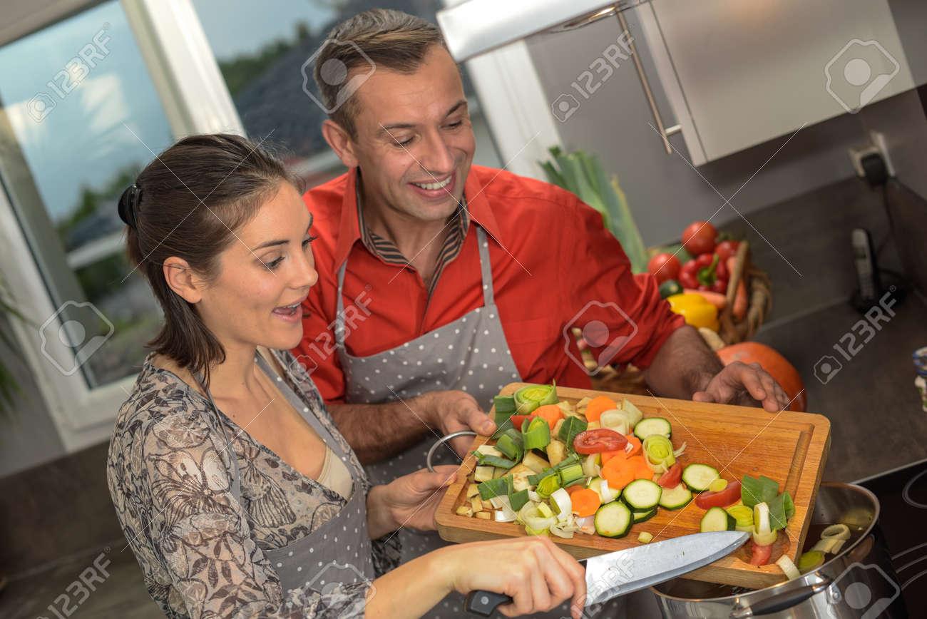 vegetarian couple preparing their meal - 159698228