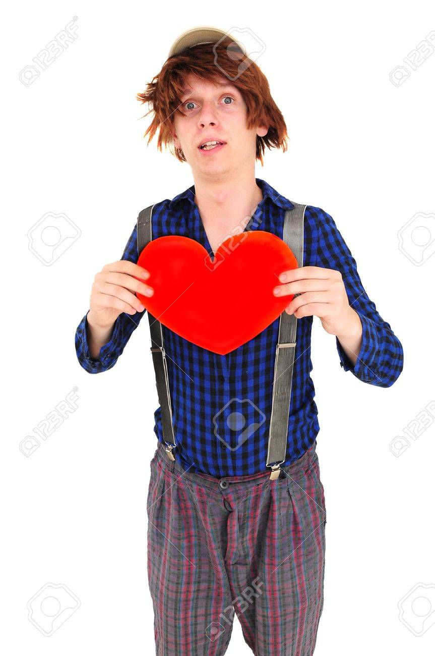 Goofy young man with funny hair and clothes holding heart Stock Photo - 12131164