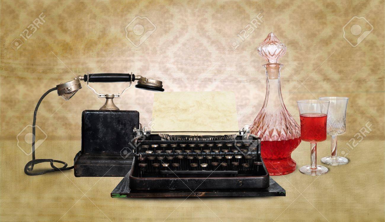 Vintage telephone, typewriter and wine bottle Stock Photo - 12132185