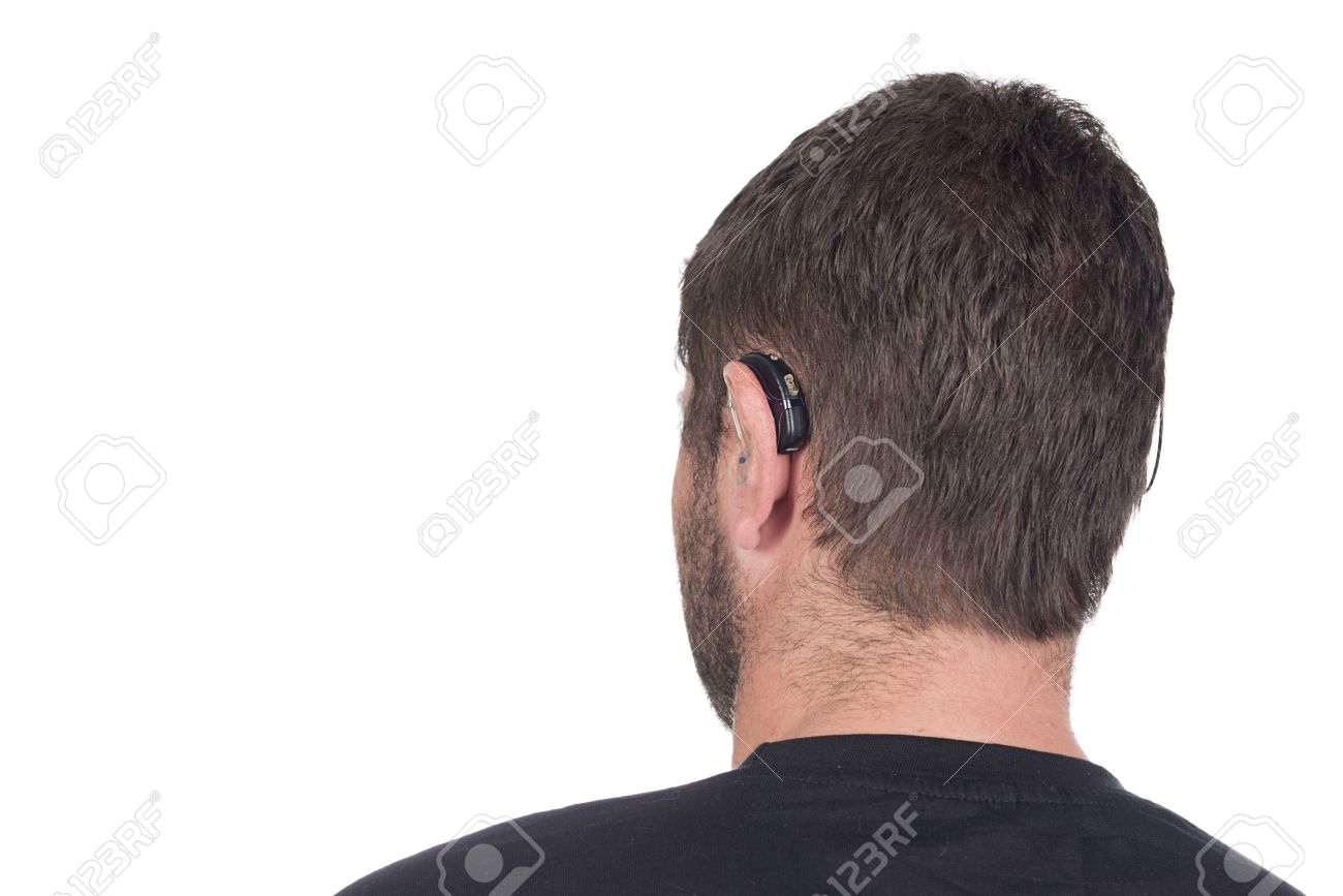 young deaf or hearing impaired man with cochlear implant and hearing aid photographed from behind to show device Stock Photo - 26329724