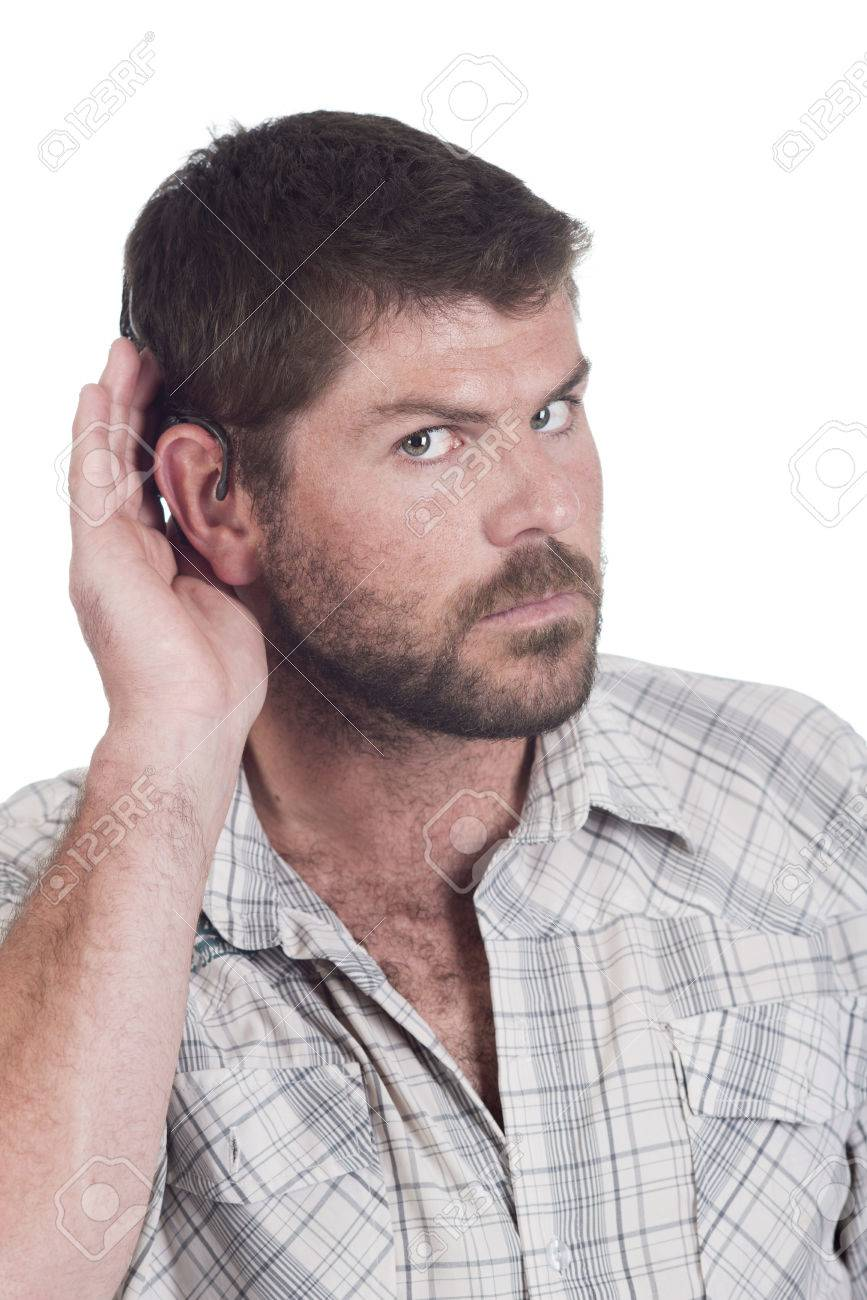 young deaf or hearing impaired man cupping one ear to listen Stock Photo - 26329854