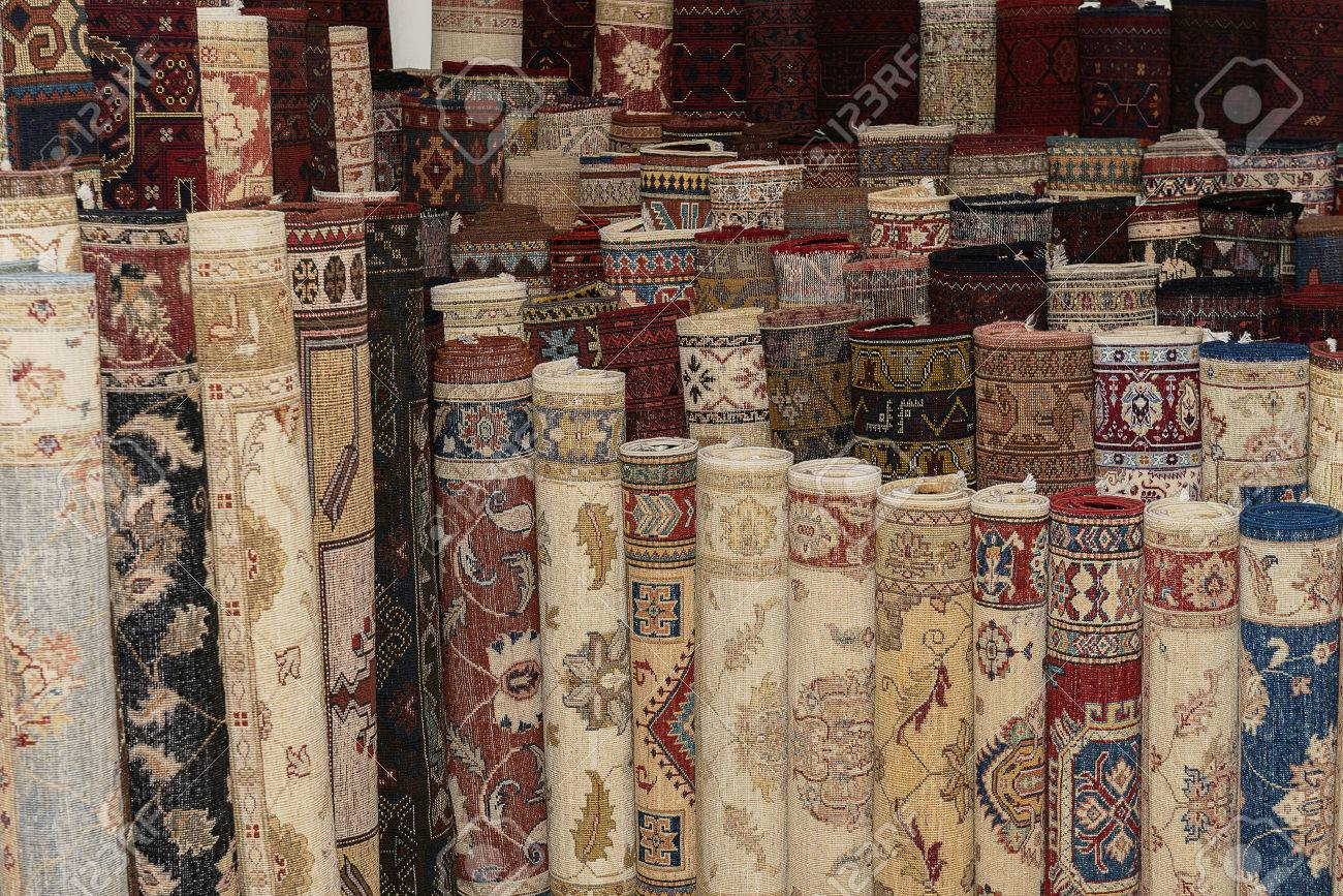 An Arrangement Of Turkish Carpets Rolled Up In A Carpet Shop Stock Photo