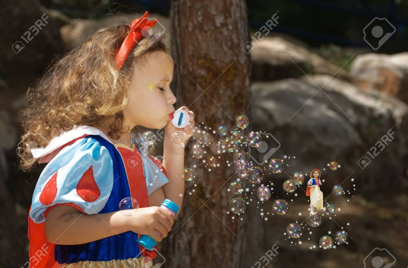 Girl blowing bubbles, image is a montage Stock Photo - 2818302