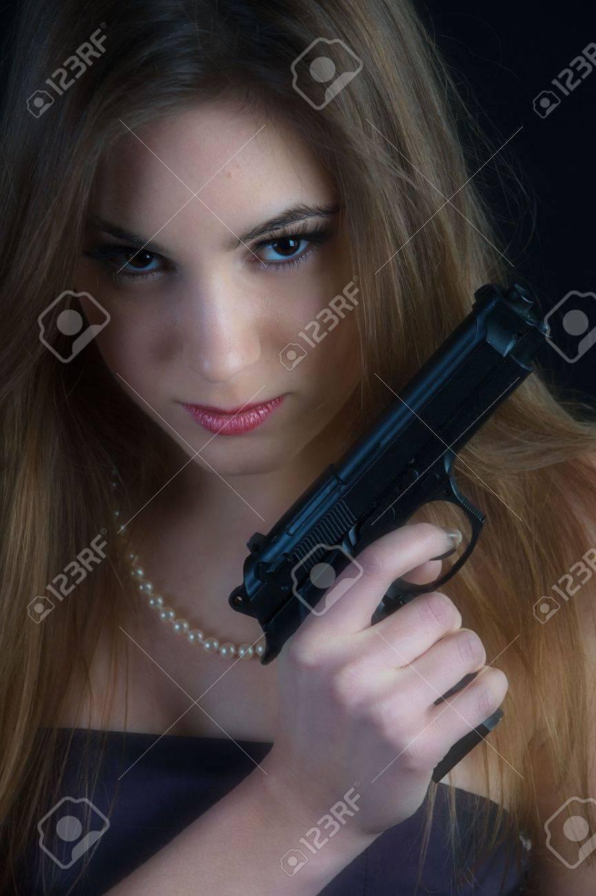 Dangerous woman with a gun Stock Photo - 4299729