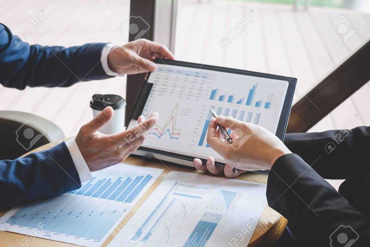 Business people team discuss and analyzing on meeting to planning investment project working and presentation strategy of business making conversation with partner, financial and accounting concept. - 124615813