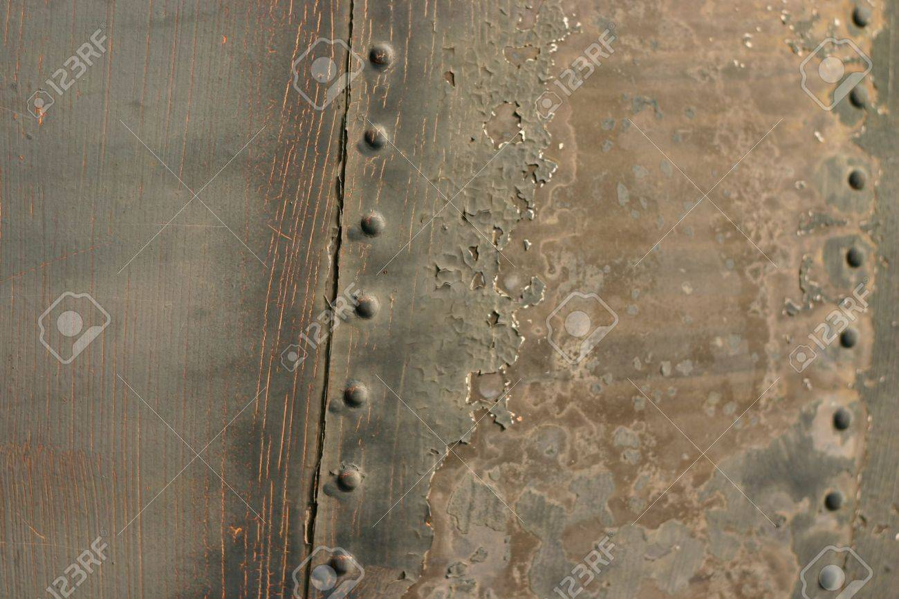 Part of an old airplane: a rusty metal plate with rivets Stock Photo - 1018756