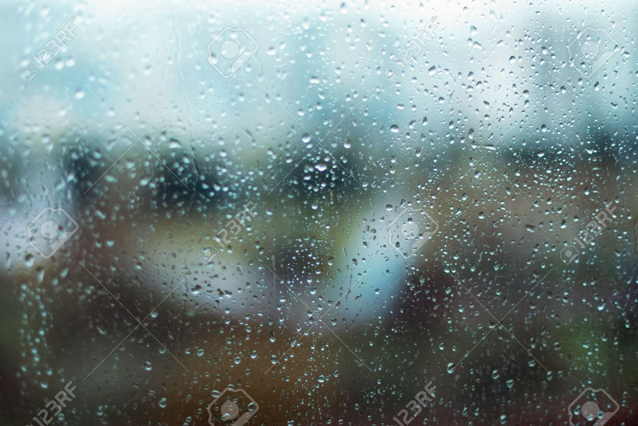 Rain drops on window glass surface. Rainy spring background - 165817078