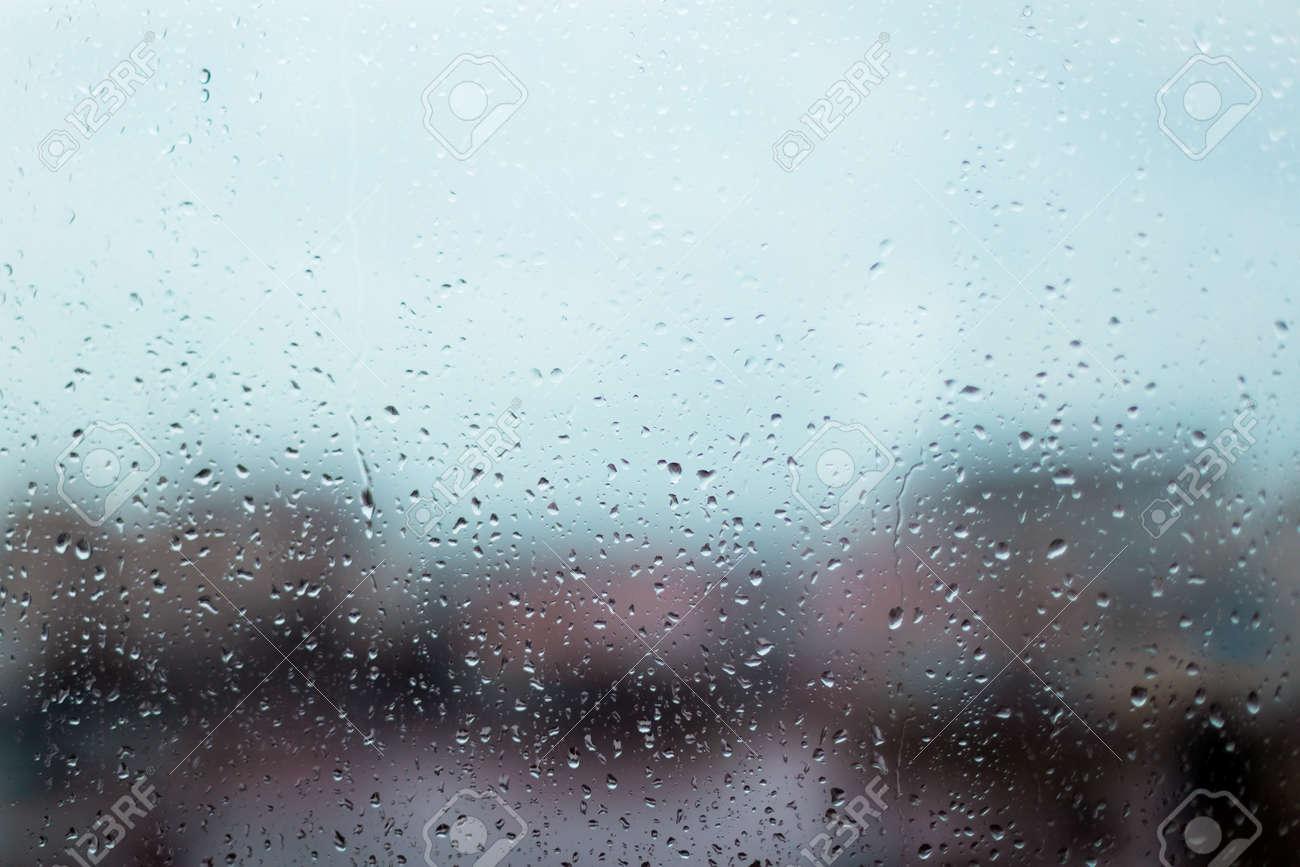 Rain drops on window glass surface. Rainy spring background - 165979515