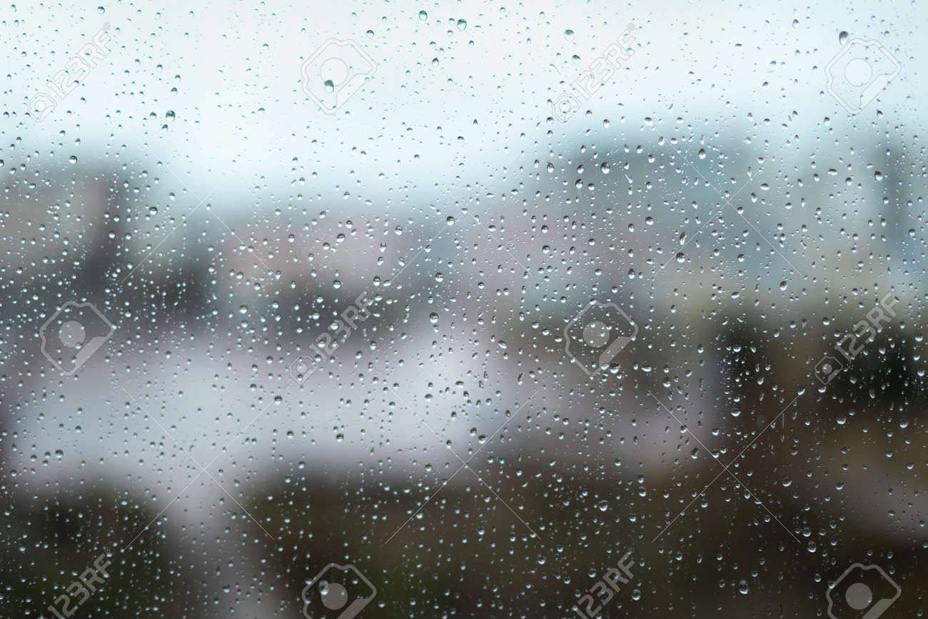 Rain drops on window glass surface. Rainy spring background - 166352622