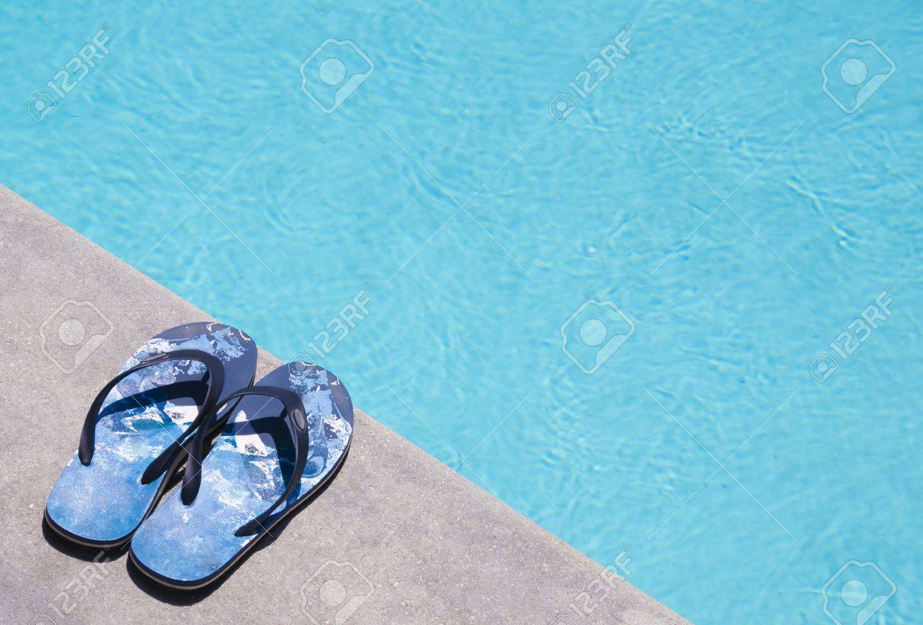ce2243fd9a8d44 Man S Flip Flops Near Swimming Pool Stock Photo, Picture And Royalty ...