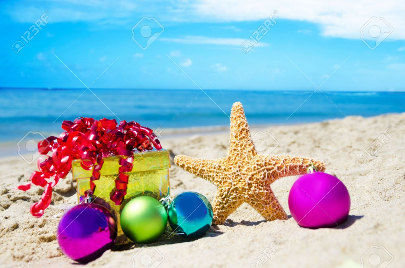Starfish with gift box and christmas balls on the beach by the ocean - holiday concept Stock Photo - 21962574