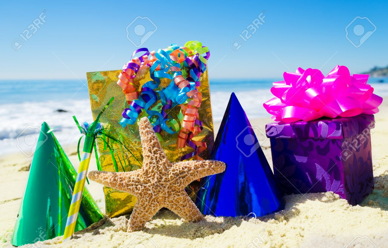 Starfish With Birthday Decorations On The Sandy Beach By The