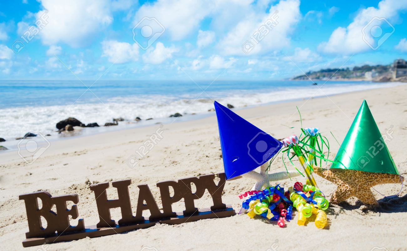 Sign Be Happy With Birthday Decorations On The Beach By The
