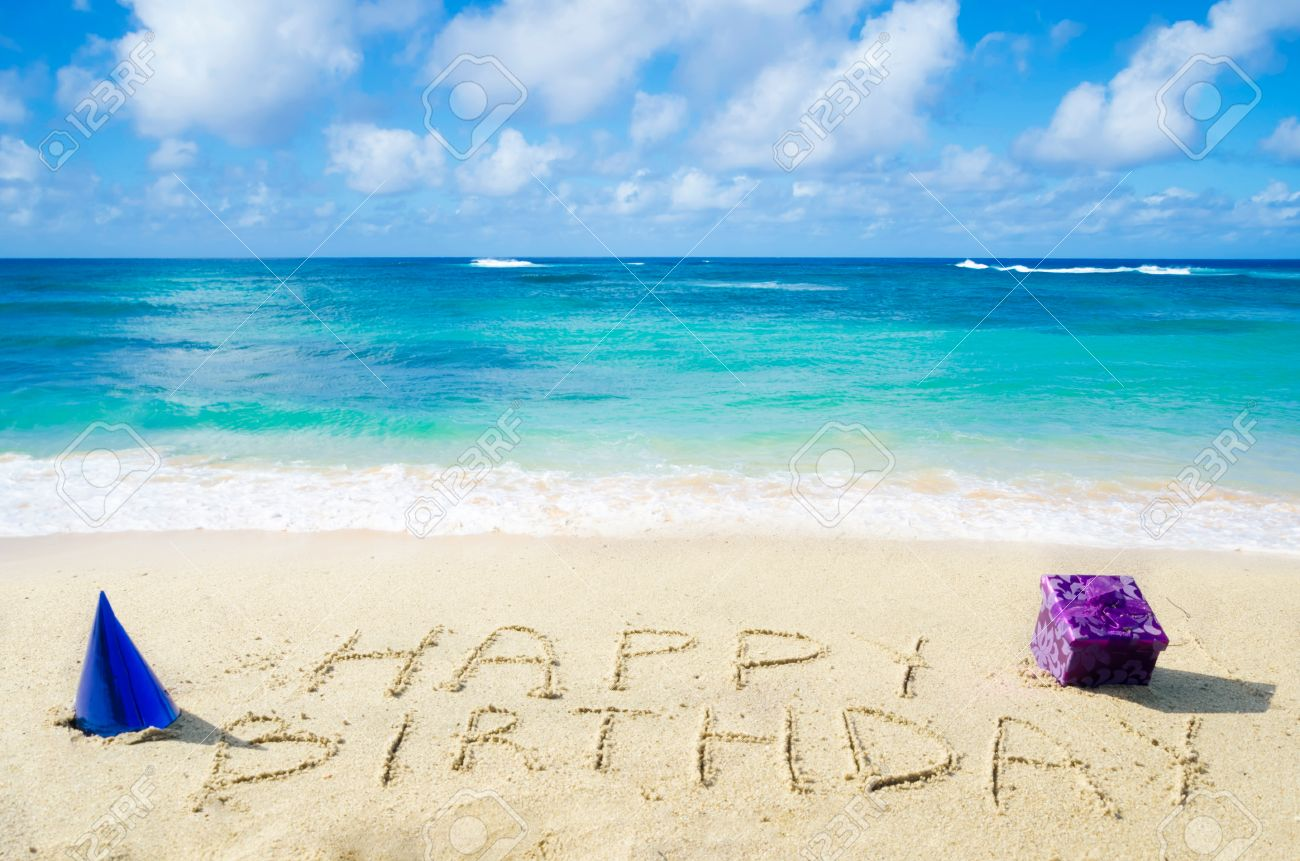 Sign Happy Birthday With Decoration On The Sandy Beach By
