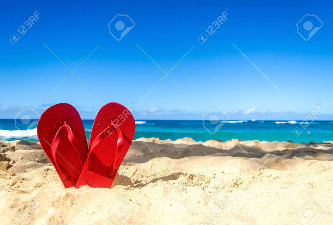 7e7585d376e2 Red Flip Flops In Heart Shapes On The Sandy Beach In Hawaii