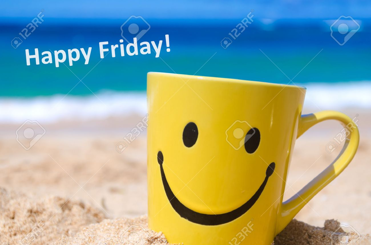 Smiley Face Mug On The Sandy Beach And Sign Happy Friday Stock
