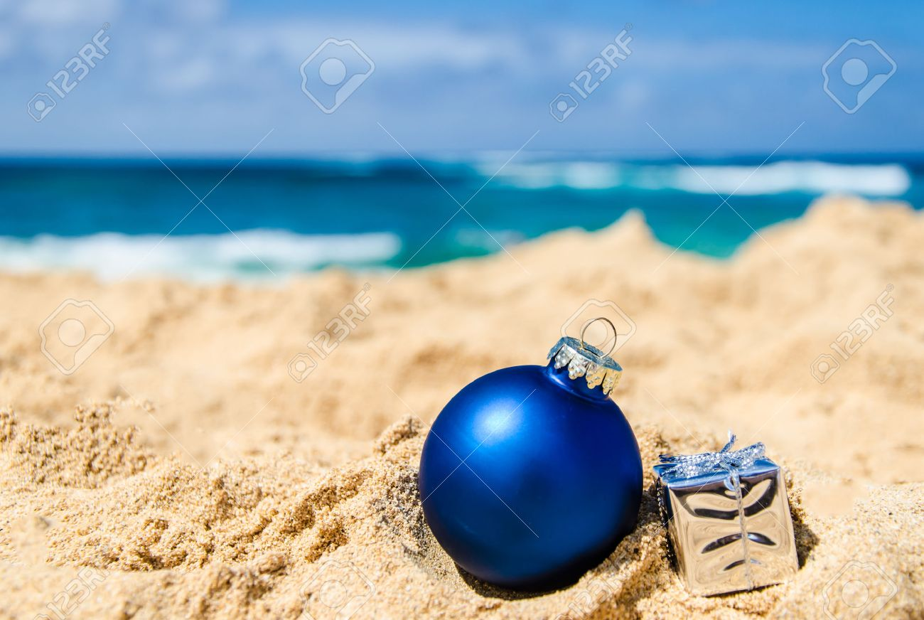 merry christmas and happy new year background with gift and ball on the tropical beach near - Beach Christmas Pictures