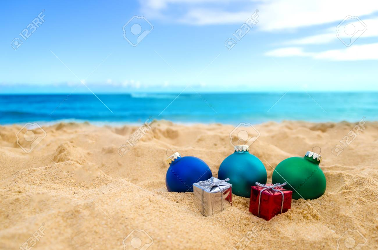 merry christmas and happy new year background christmas balls and gifts on the tropical beach