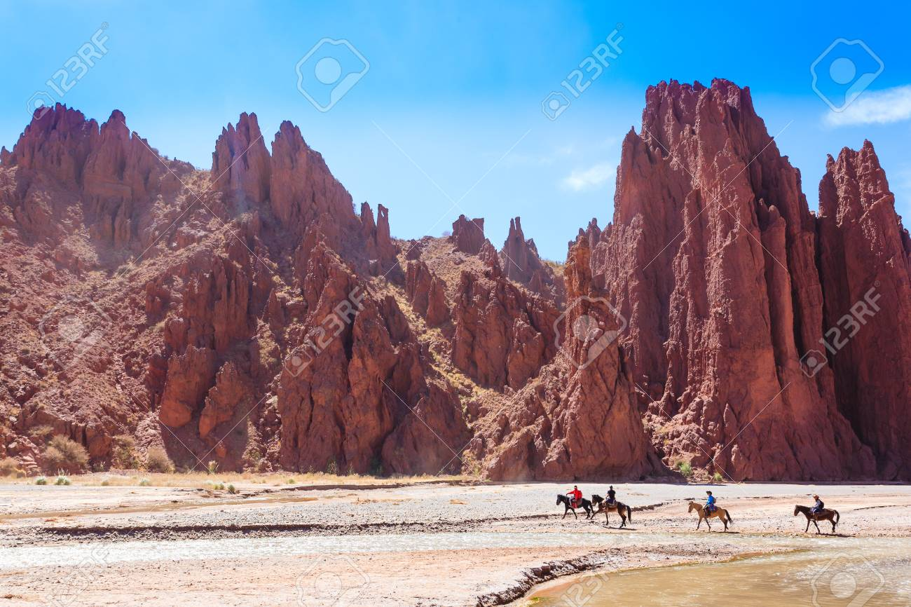 Horse Riders Crossing River From Duende Canyon Bolivia Outdoor Stock Photo Picture And Royalty Free Image Image 96498160