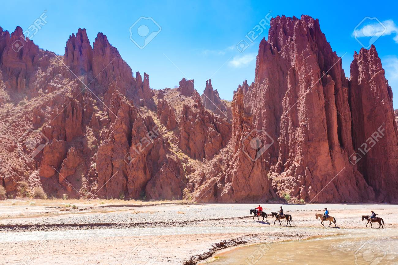 Horse Riders Crossing River From Duende Canyon Bolivia Outdoor Stock Photo Picture And Royalty Free Image Image 98001972
