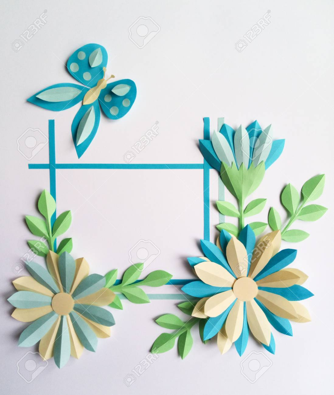 Square Frame With Blue Color Paper Flowers And Butterfly Nature