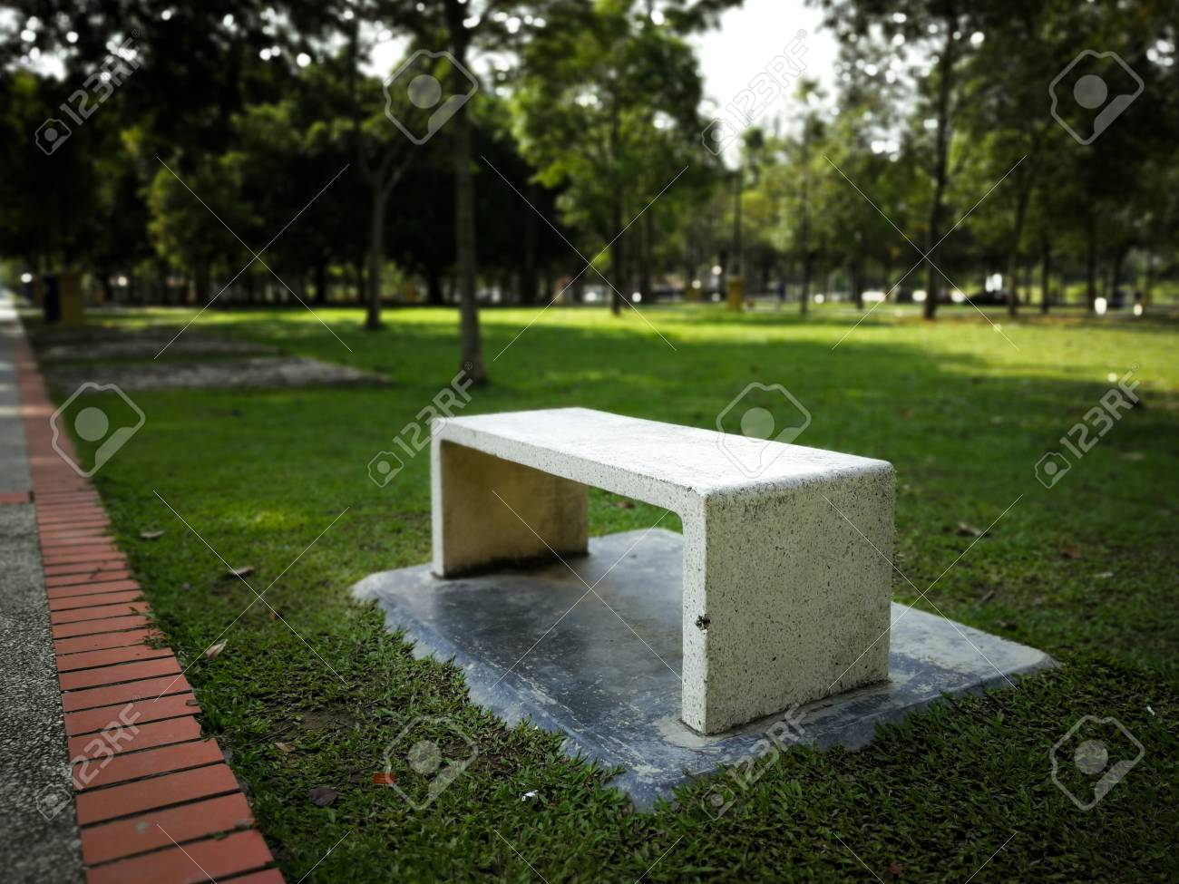 Concrete Park Bench Nobody Sit In The Green Grass Park And Red