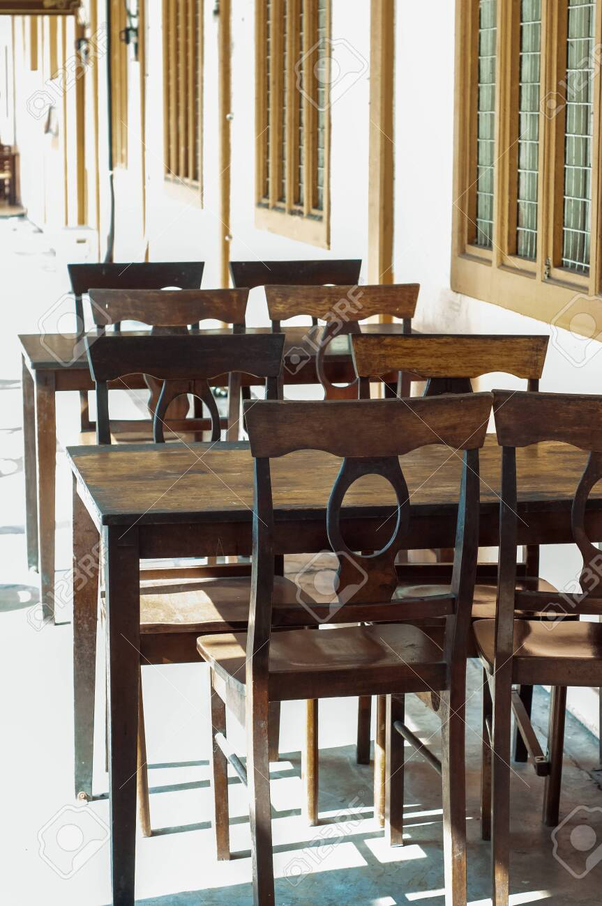 Dark Dining Table With Wooden Chair And Vintage Restaurant Stock Photo Picture And Royalty Free Image Image 140940101