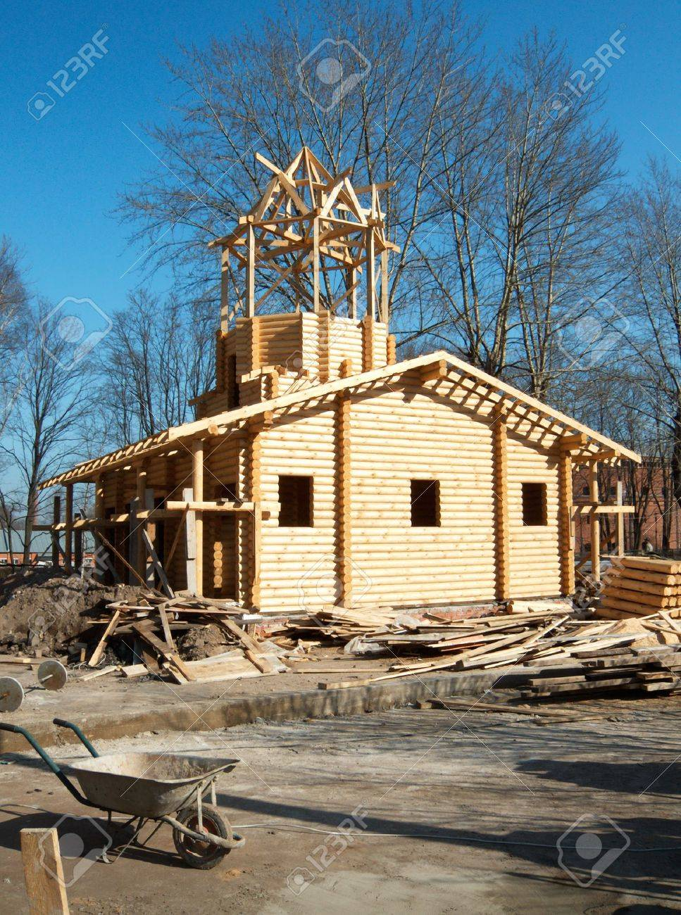 Construction the large log house with a turret at top - 1269499
