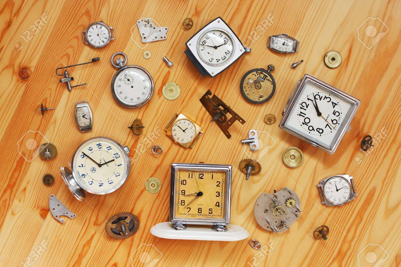 Watch wrist parts - Stock Photo The Old Alarm Clocks Wrist Watches Stop Watch And Clock Parts Lie On A Wooden Surface