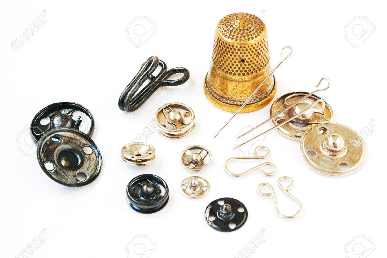 Vintage Snap Fasteners And Bronze Thimble Stock Photo