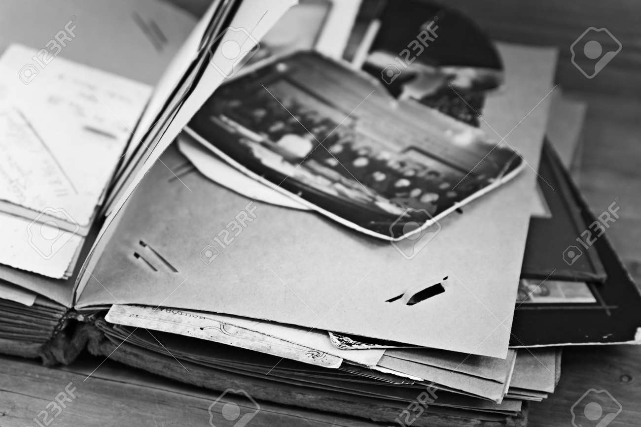 Page of retro photograph album with photos, black and white - 171435557