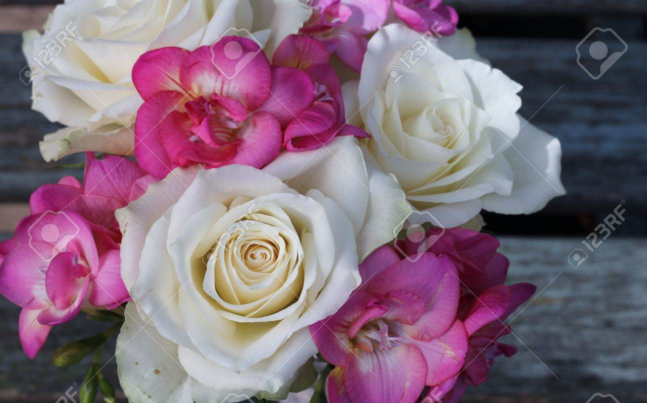 Pretty Small Posy Of Cream Roses And Pink Fuchsia Tied Bouquet