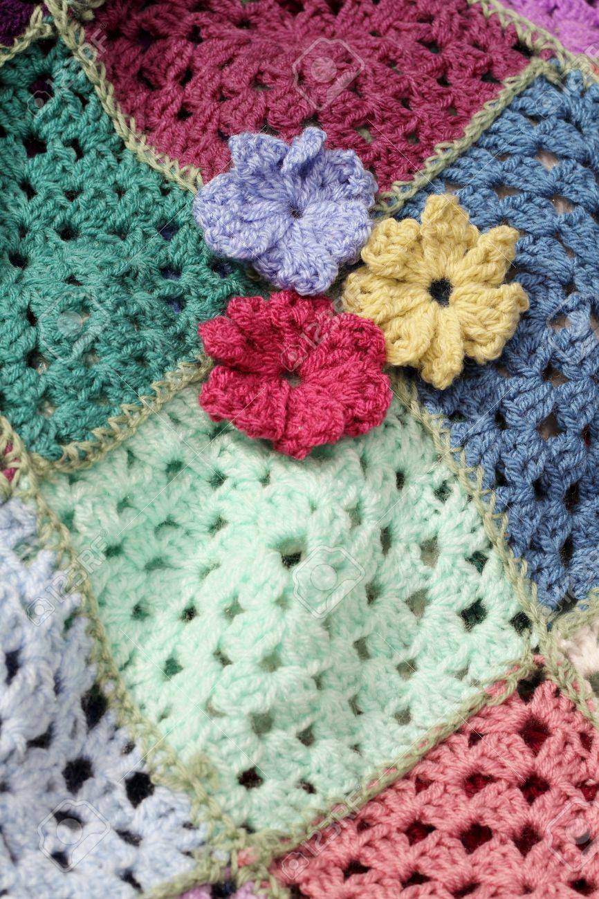 Crocheted Flowers On A Square Patch Work Afghan Crochet Blanket ...