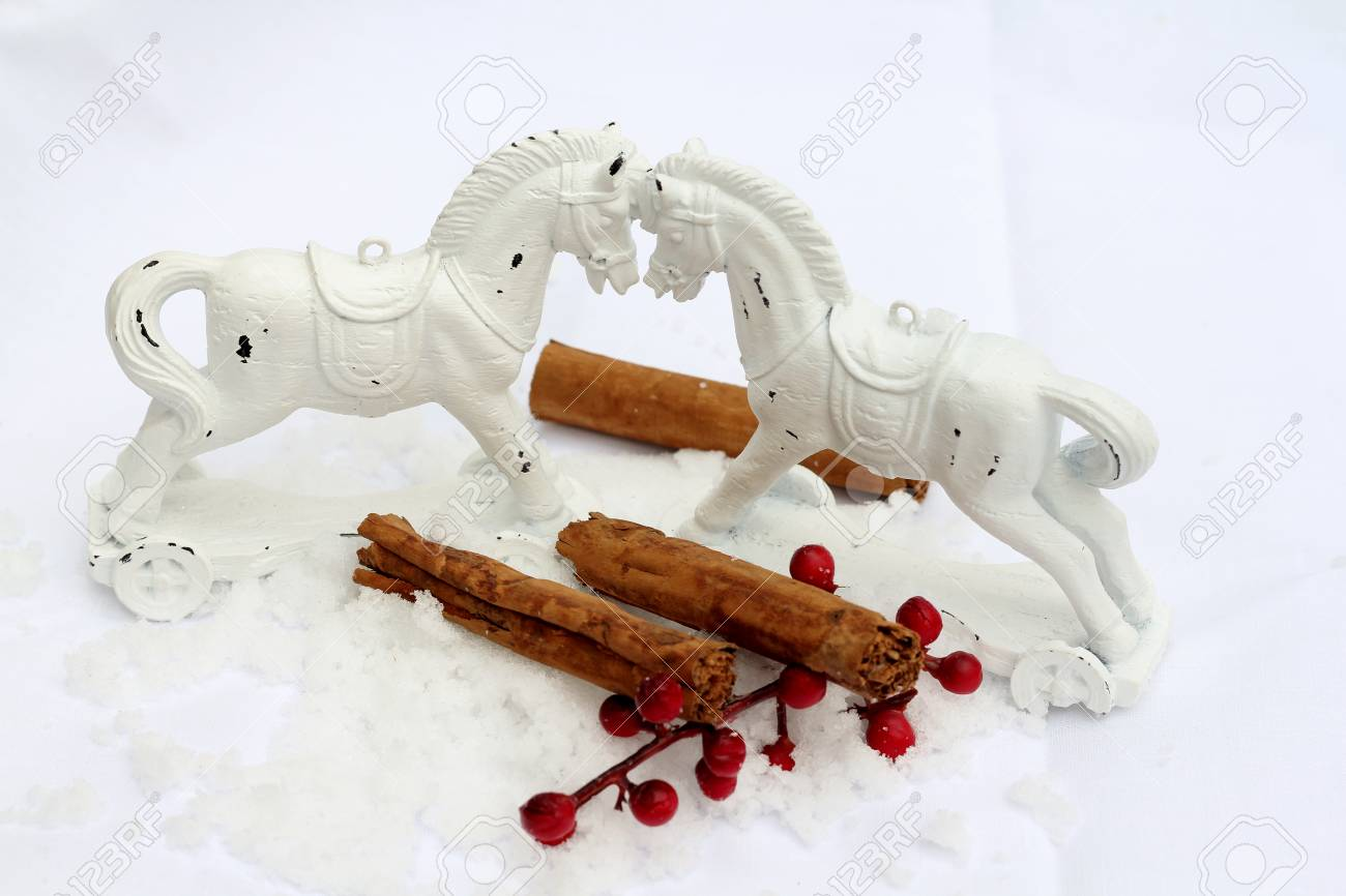 Retro Weihnachtsbilder.Two Retro White Rocking Horse Decorations In The Snow With Red