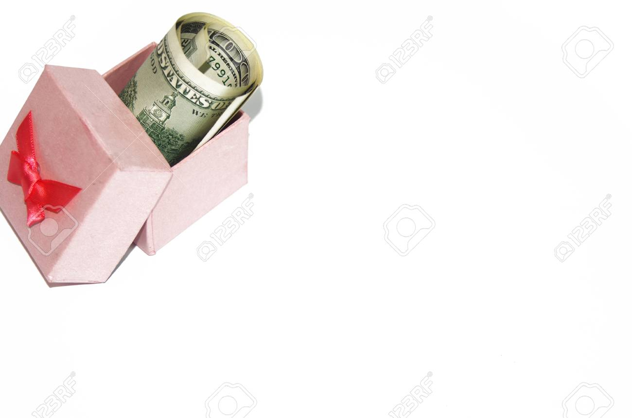paper bag with american dollars and red ribon bow decoration christmas shopping Stock Photo - 28080668