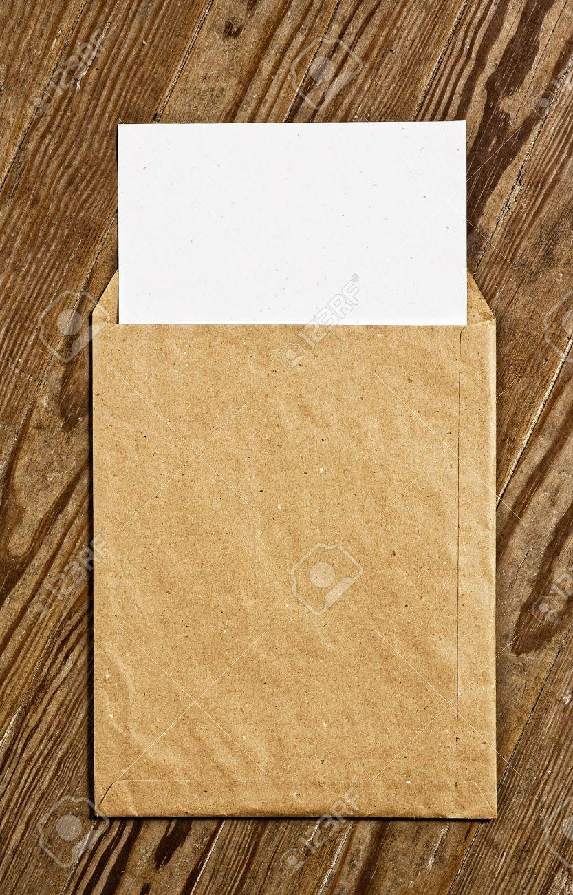 Open Brown Vintage Envelope, with white paper, over wooden surface. Stock Photo - 3709562