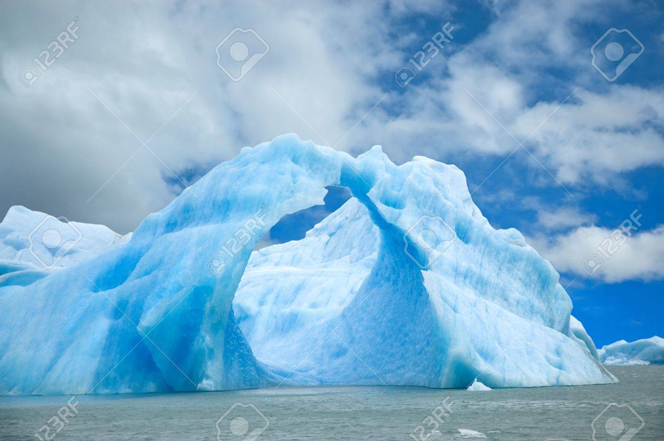 Iceberg floating in the water forming an arch. Stock Photo - 4326697