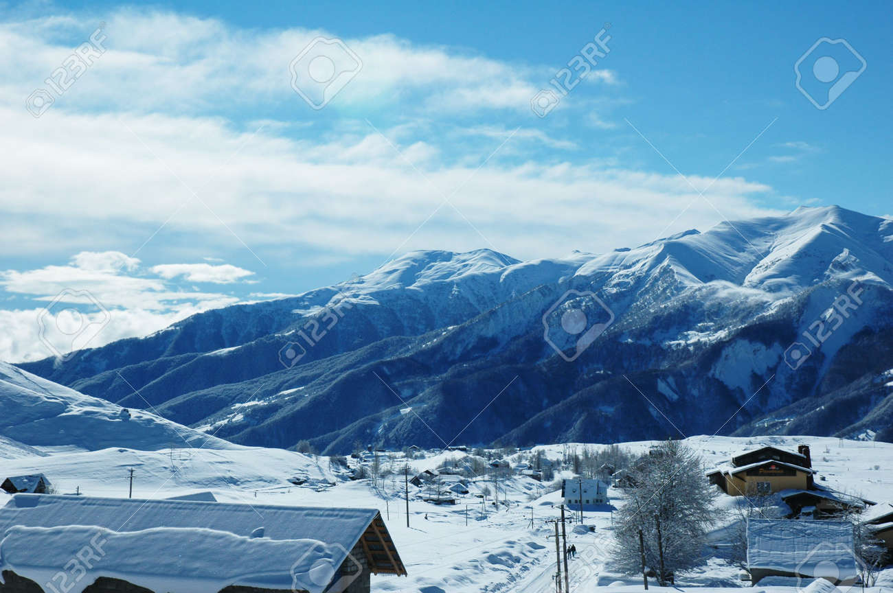Small village and mountains covered with the snow Stock Photo - 730355