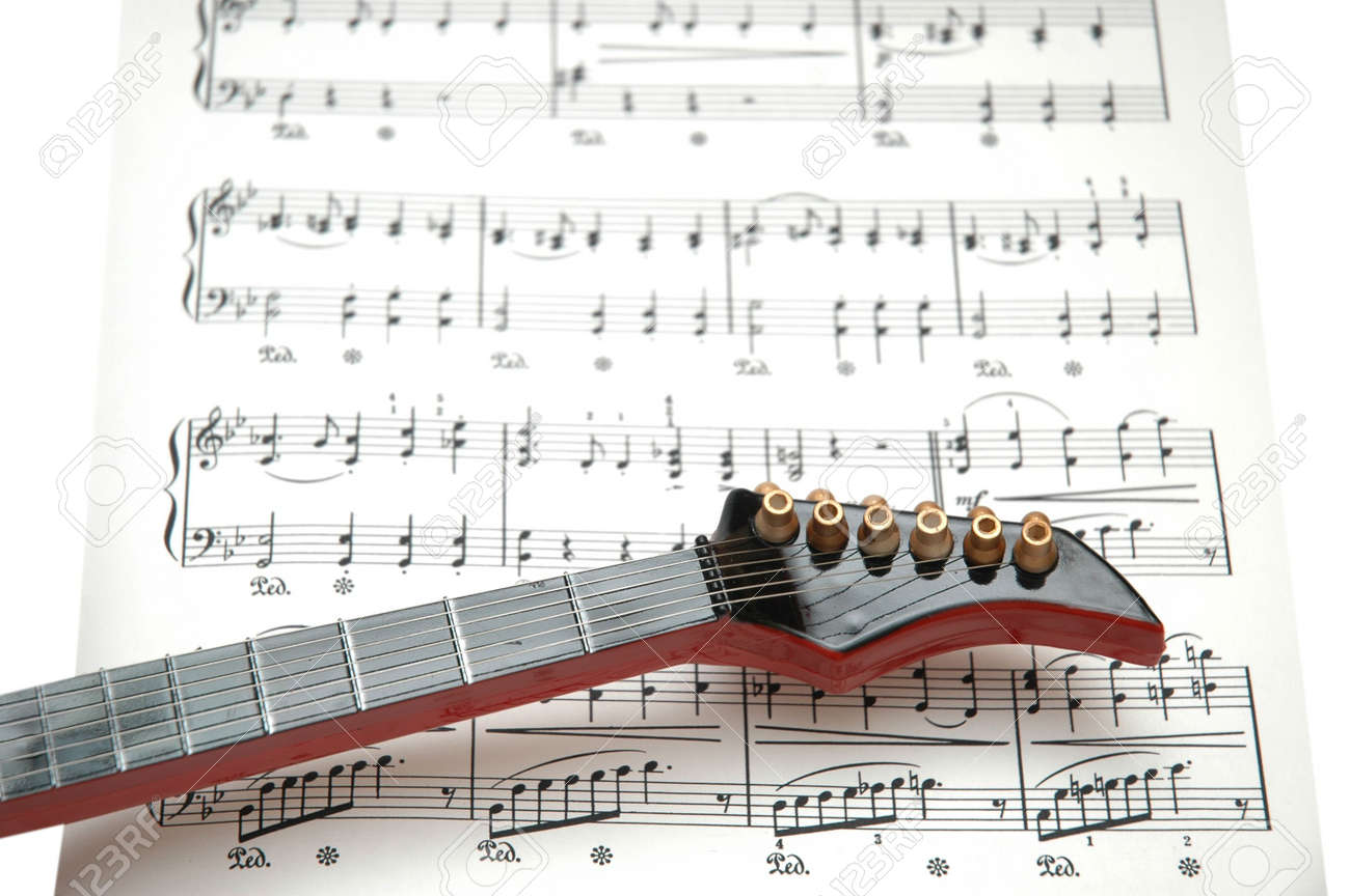 Rock Guitarra En La Hoja De Música Impresa Fotos, Retratos, Imágenes ...