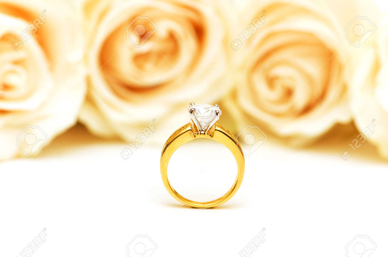 Roses and wedding ring isolated on the white Stock Photo - 2908832